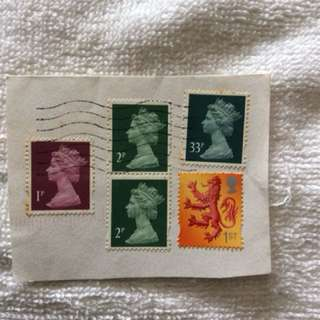 UK stamps still intact with cutting envelope
