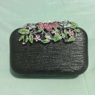 Jeweled black clutch with removable strap