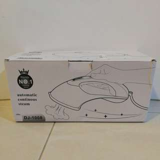 Travel steam iron (pink color)
