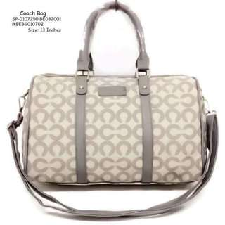 Coach bag size : 13 inches