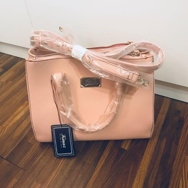 Kinaz 粉色手提側背包
