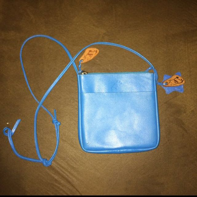 OUR TRIBE SLING BAG AUTHENTIC