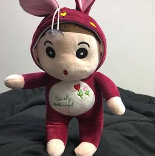 Boy in rabbit toy