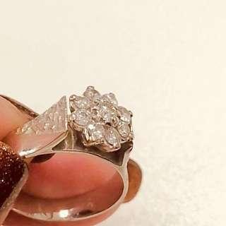 Diamond ring size 52.   Or 12.    18 karats. White gold.  With diamonds.