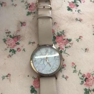 Christan Paul marble watch