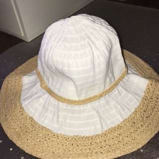 White and brown straw hat