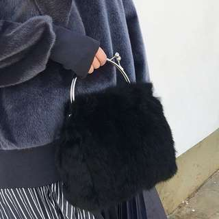 Black fur handle bag