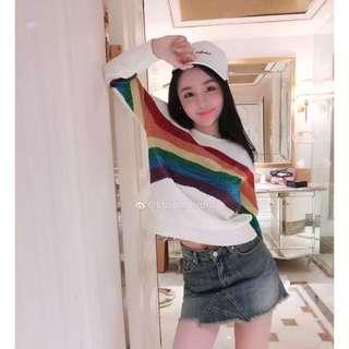 White rainbow sweater.