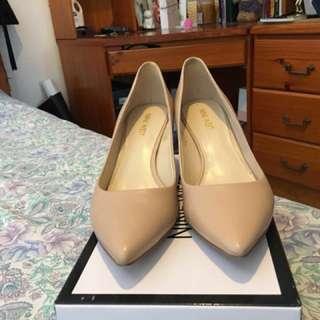 Nine West nude short heels in size 8