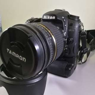 Nikon D7000 only + battery pack + 2 ori battery+ charger