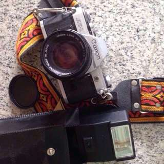 Canon AE1 with FD 50mm 1.4 lens and flash