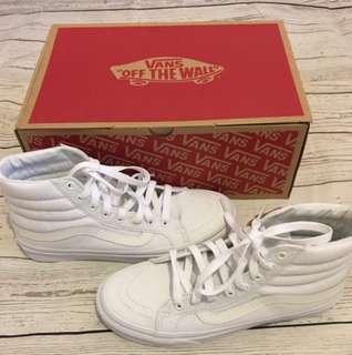 All white sk8 hi vans