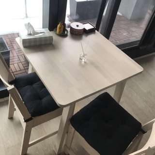 Dinnig  table and two chairs