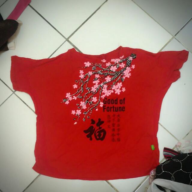 Atasan Imlek Sakura Ong