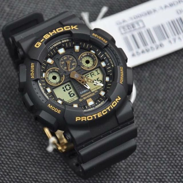 0f6b8caeede28 Authentic Brand New Casio G-Shock GA-100GBX-1A9 Black and Gold Men s ...