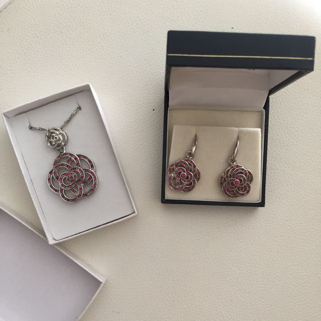 Authentic Swarovski necklace and earrings