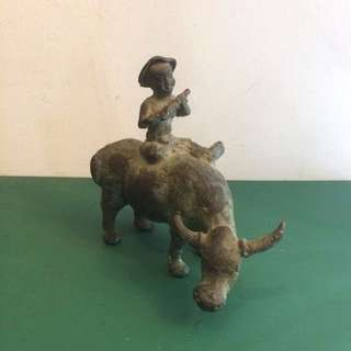 Bronze sculpture figurine boy with flute on water buffalo