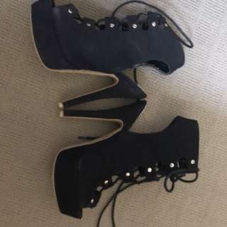 Black platforms lace up