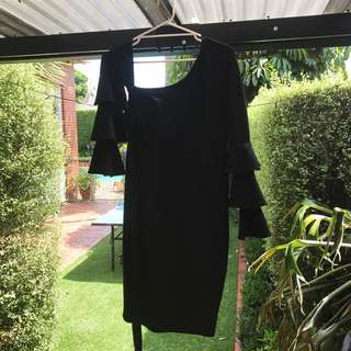 Sleeves are same length just on hanger. One shoulder frill Spanish arms wrap around waist black dress