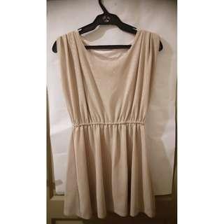Shimmery Champagne- colored sleeveless minidress, garterized skirt