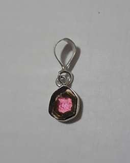 Exquisite Watermelon Tourmaline slice pendant nicely wrap and set in 100% 925 silver setting. Its definitely not just worth for keeping and also elegant to put on.