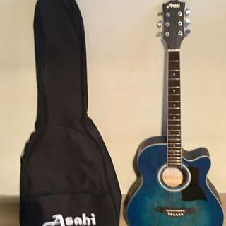 Asahi acoustic guitar with bag, few months old seldom use