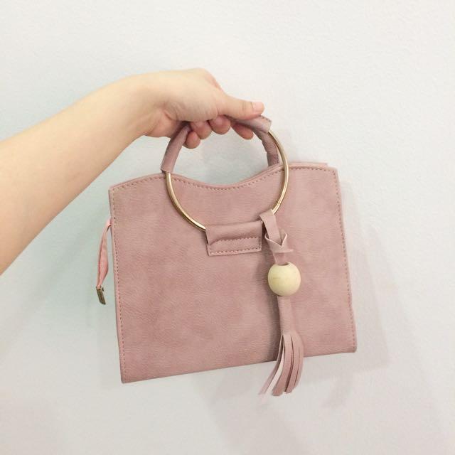 Round Ring Pink Handbag