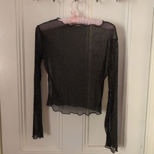 Sheer glitter lettuce hem long sleeve top