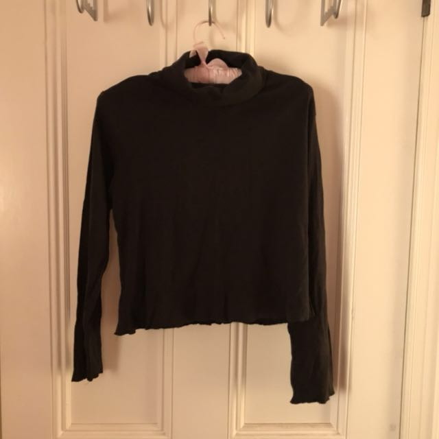 Slightly cropped black long sleeve roll neck turtleneck