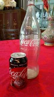 Coca cola bottle and can
