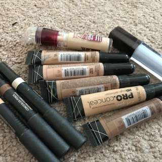 LOT of Concealers and a bkue corrector
