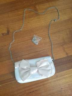 White, pink bow, silver chain clutch