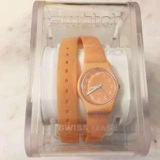 Swatch pastel peach wrap around watch