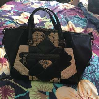 Authentic black and white fully leather Coach handbag