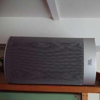 A pair of JBL bookshelf speakers