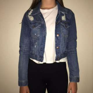 Ripped denim jacket.