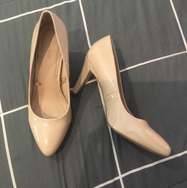 Beige mid height heels
