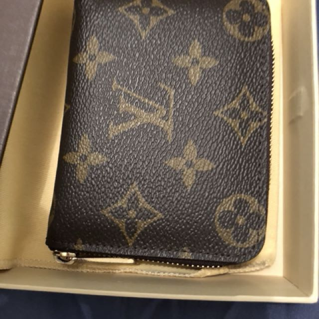 Lv zipper wallet *authentic* postage only
