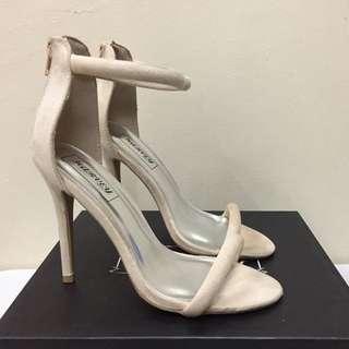 Nude pink stilettos with zip-up on the heel