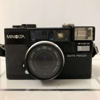 Minolta 35mm Film Camera, Model: HI-MATIC AF2, built in flash, Auto Focus, Made in Japan; Include casing with arm strap