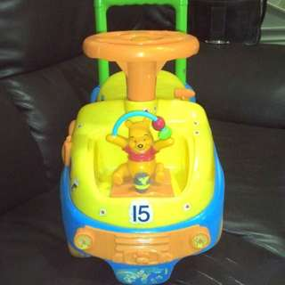 Pooh-Baby Walker and storage