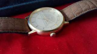 Year of Guinness gold watch .