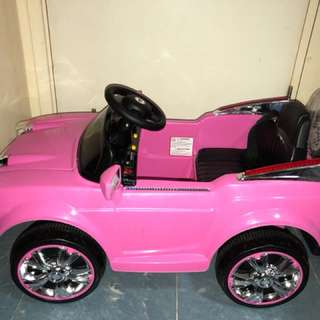 Pink mini car with music, remote and battery