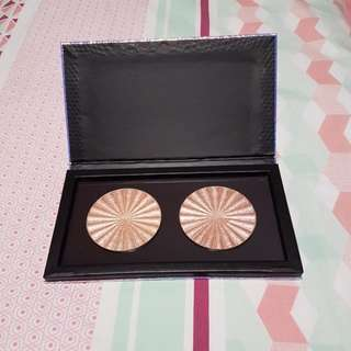 Ofra Cosmetics highlighters in Rodeo Drive and Glow Goals in a large magnetic palette