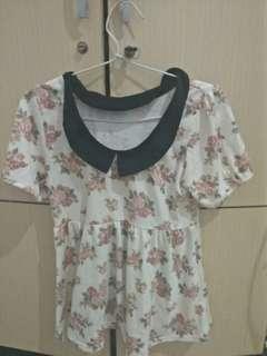 Kaos motif bunga