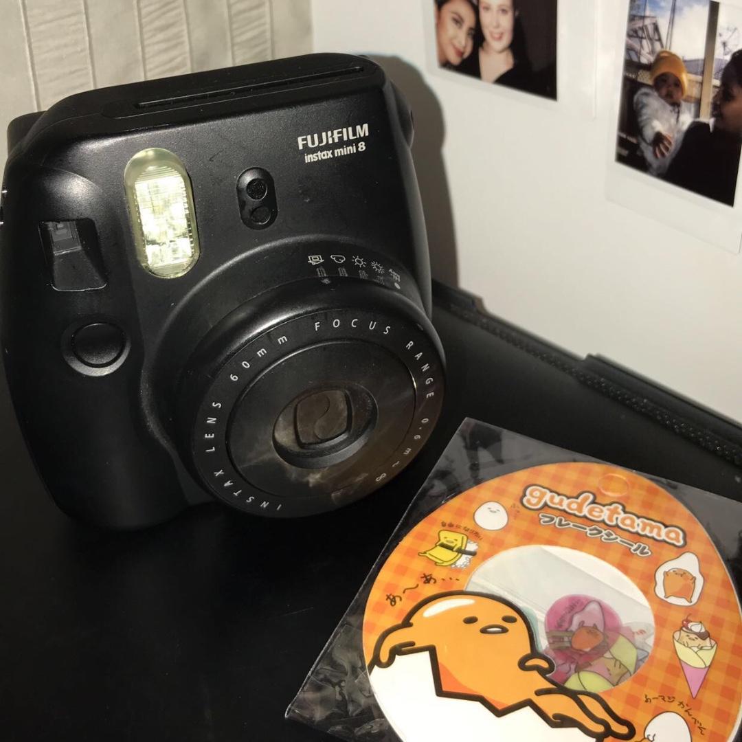 black polaroid camera with gudetama sticker photography on carousell
