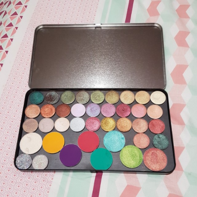 40 eyeshadows. Makeup Geek and Colourpop and Juvias Place eyeshadows in a extra large magnetic palette