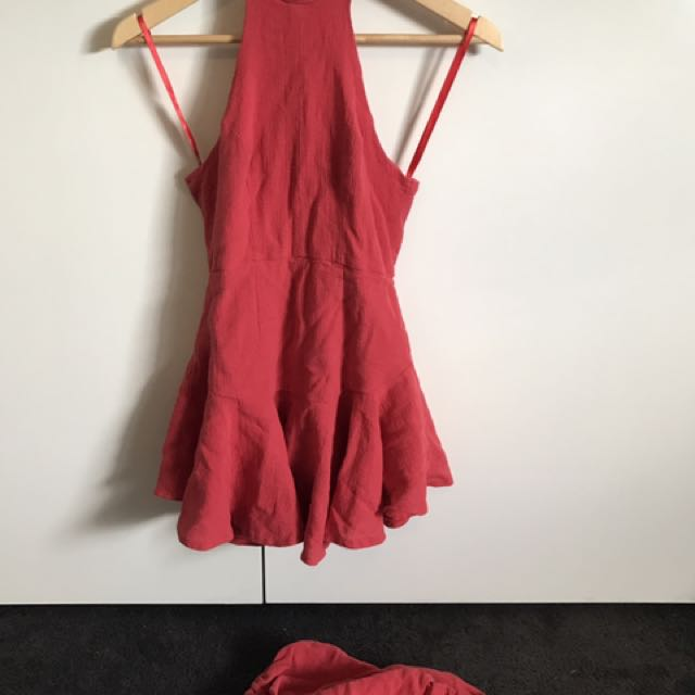 Red playsuit/dress with attachable sleeves.