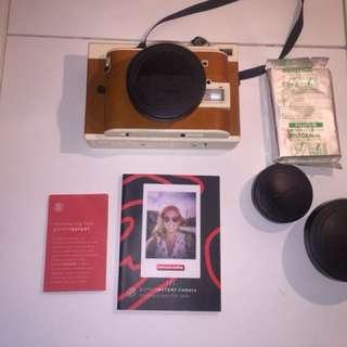 Polaroid camera with lanyard, 3x lenses, and 3x film
