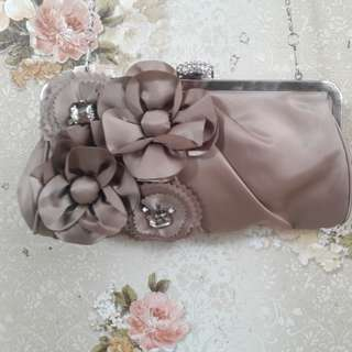 Brown sling bag